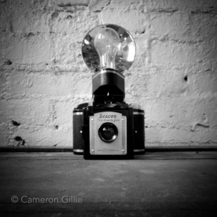Pinhole photograph of a vintage camera.